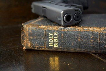 Bible with a 9mm pistol.